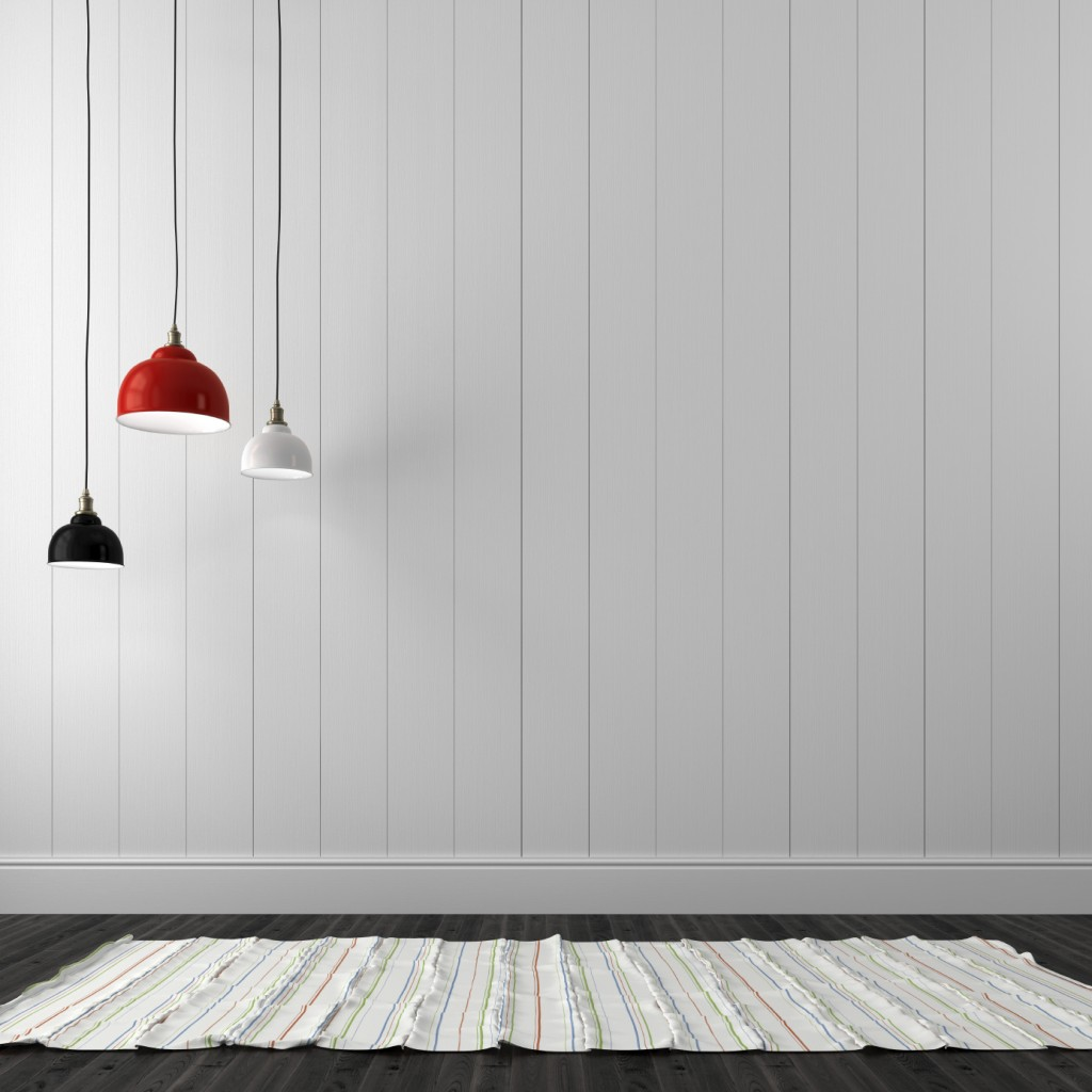 Chandeliers of different colors against the background of white wall boards